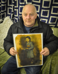Peter Kelly with a photograph of his mother